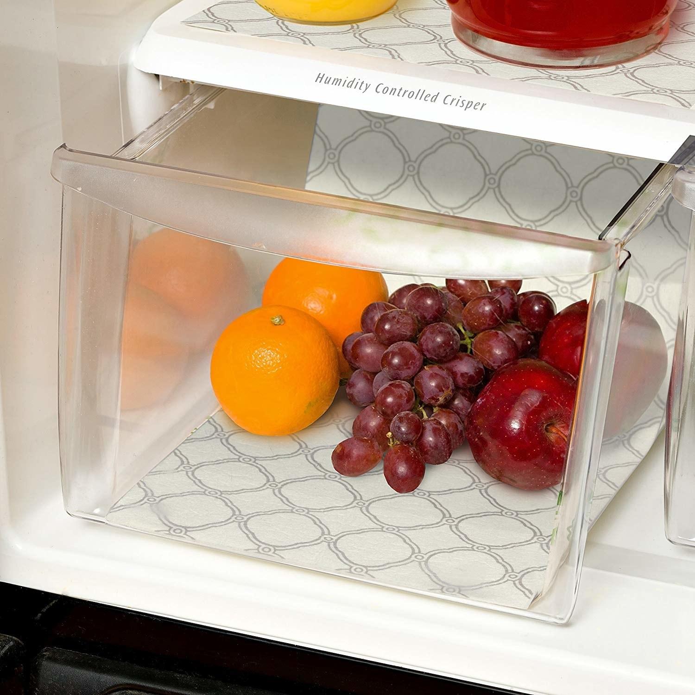 open fridge crisper drawer with the liner on the bottom