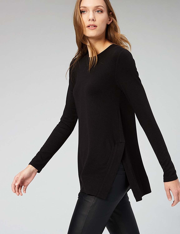 Model wearing the sweater in black