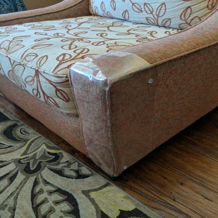 Reviewer photo of the clear protector wrapped around the base of an armchair