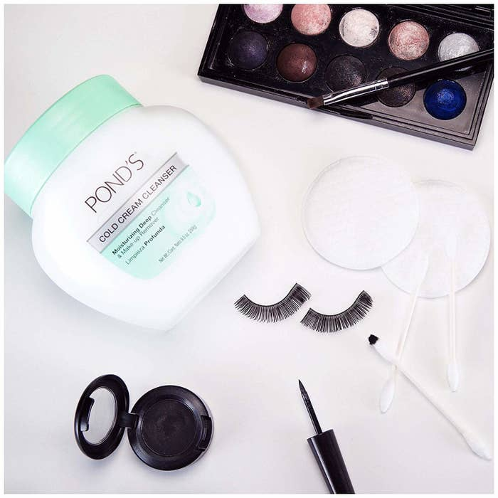 the Pond's cold cream cleaners with various makeup bag essentials