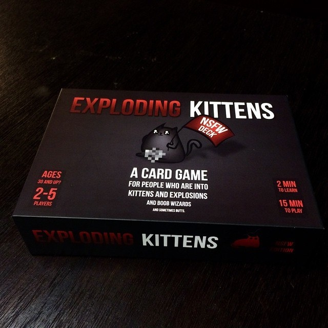 A box of the exploding kittens card game