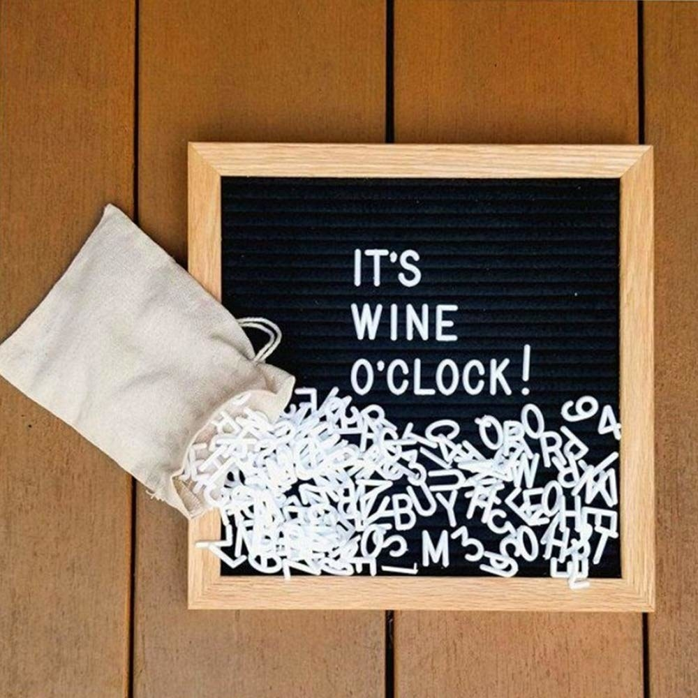 A mini felt letter board with a bag filled with letters and symbols