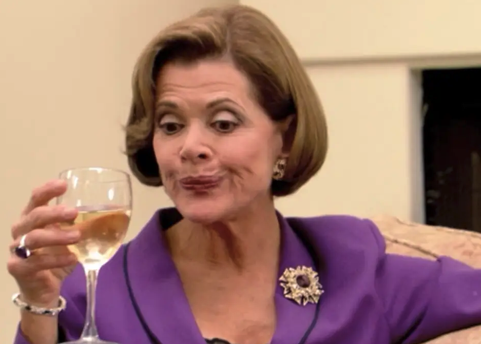 Lucille Bluth sipping wine
