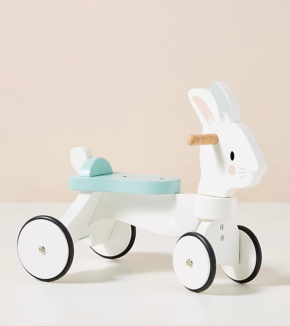Rolling wooden ride-on toy shaped like rabbit