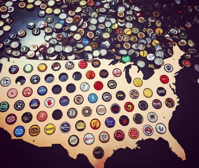 reviewer image of beer caps in each hole in the map