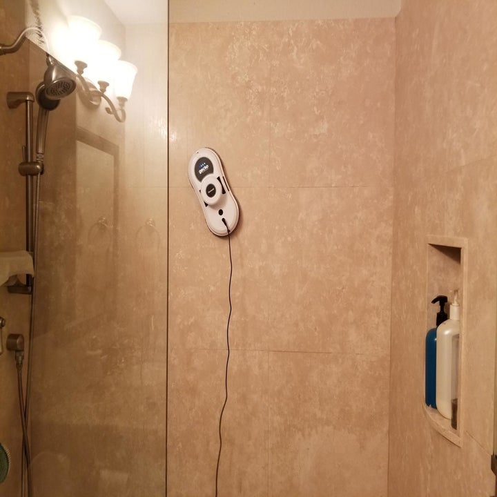 Reviewer image of the cleaner cleaning a shower wall