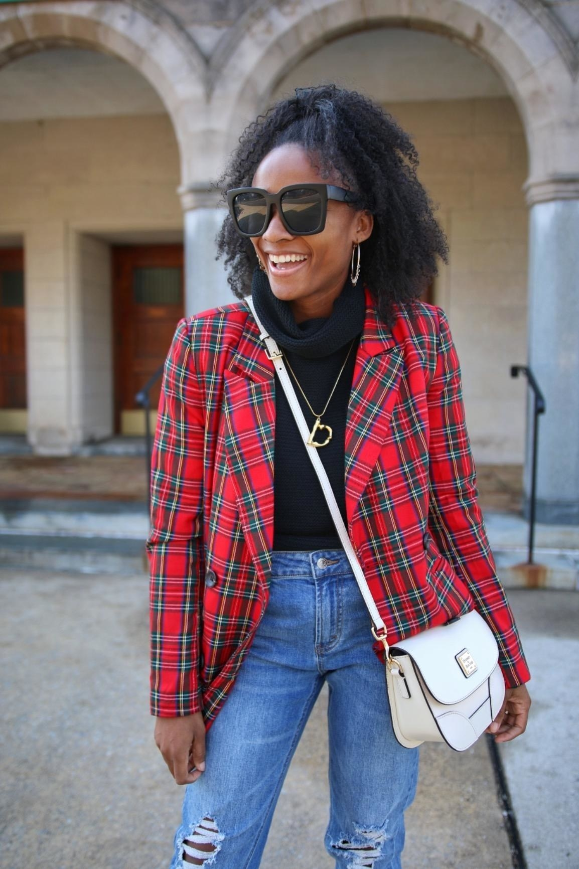 Reviewer wearing the blazer in red and green plaid print