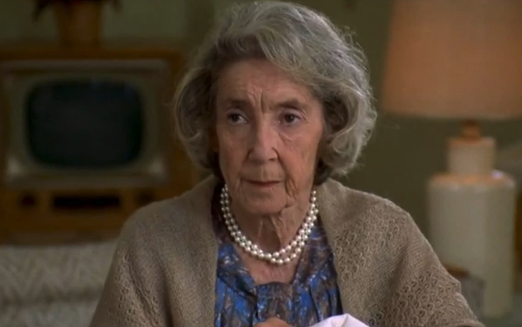 """The grandma from """"Happy Gilmore"""" sitting in her nursing room"""