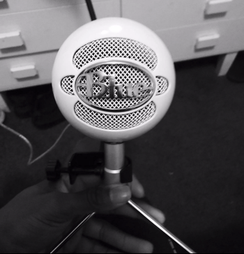 a reviewer photo of the microphone in white