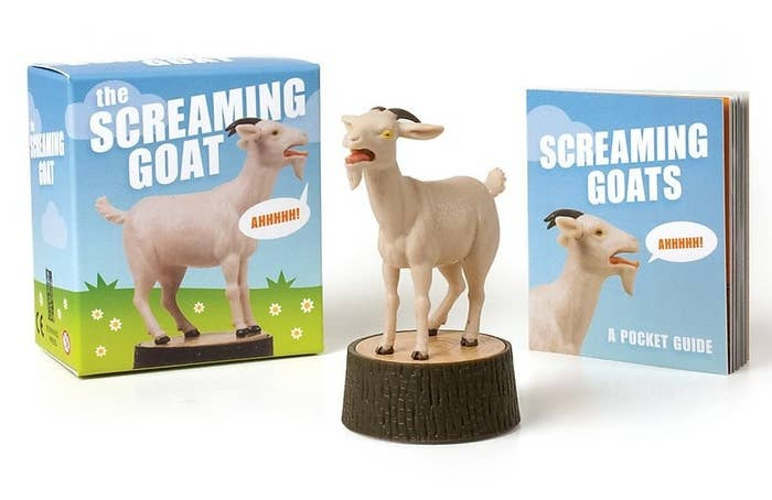 The goat standing on a stump figurine, its packaging, and the mini booklet