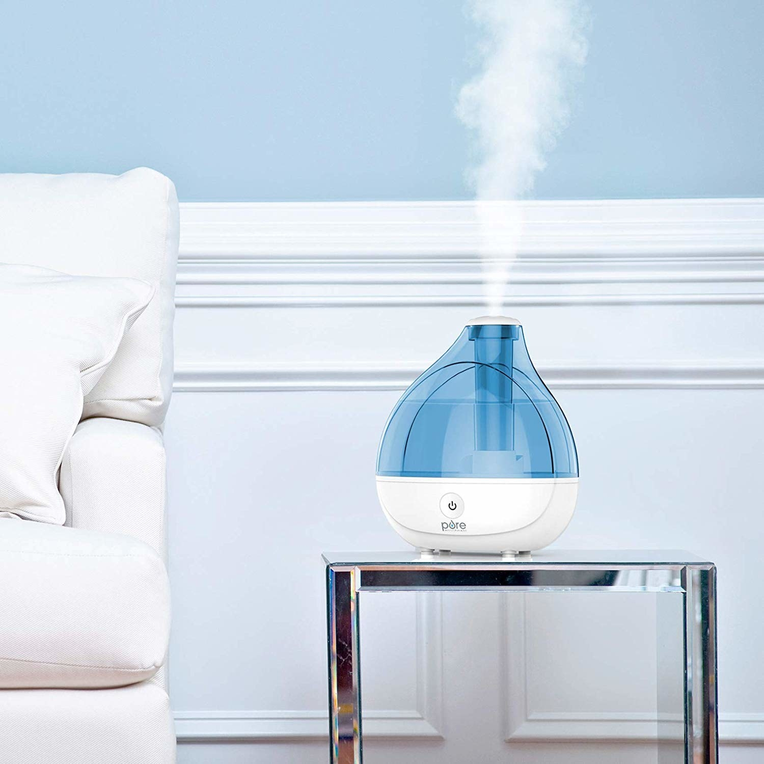 Humidifier placed on table with mist coming from the top