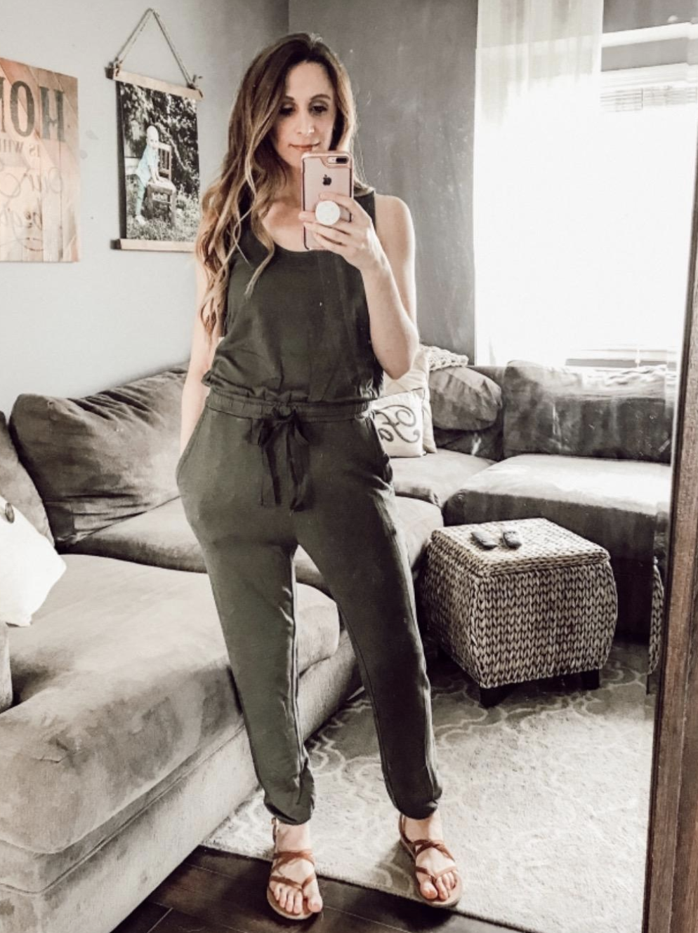 reviewer wearing the jumpsuit in olive green