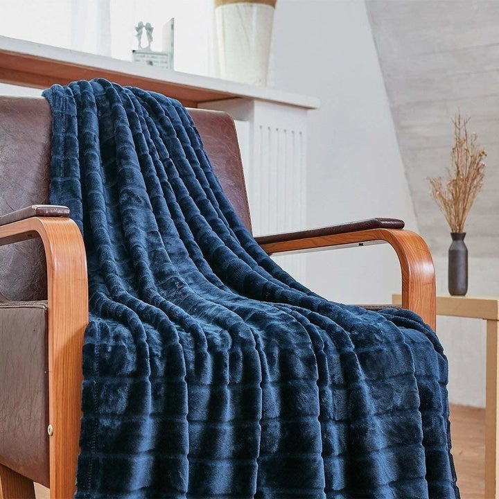 the blue blanket on a chair