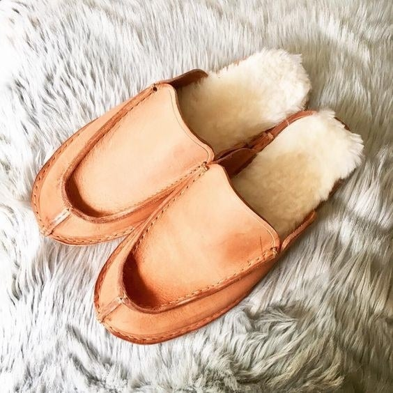 pair of slip-on slippers with the insoles peeking out of them