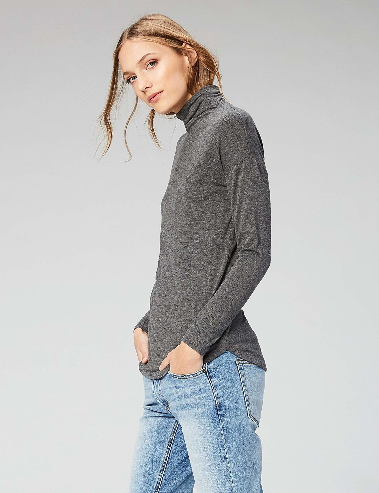 Model wearing the gray turtleneck