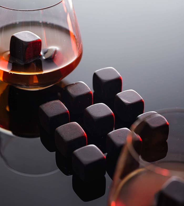 The black cubes next to a glass of whiskey