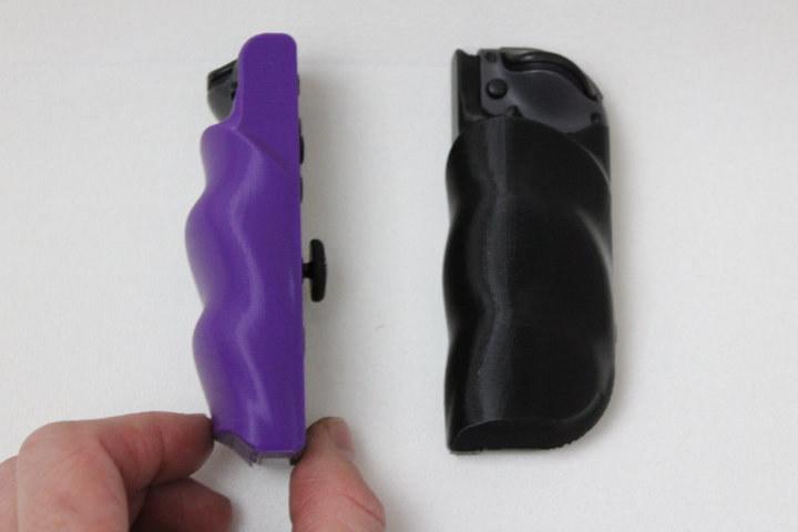 a purple and a black grip for the nintendo joycons
