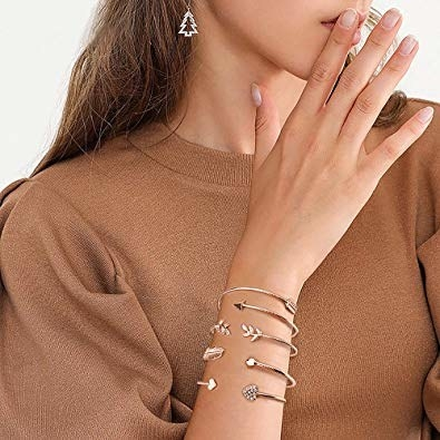 model wearing four of the minimalist bracelets stacked on one wrist