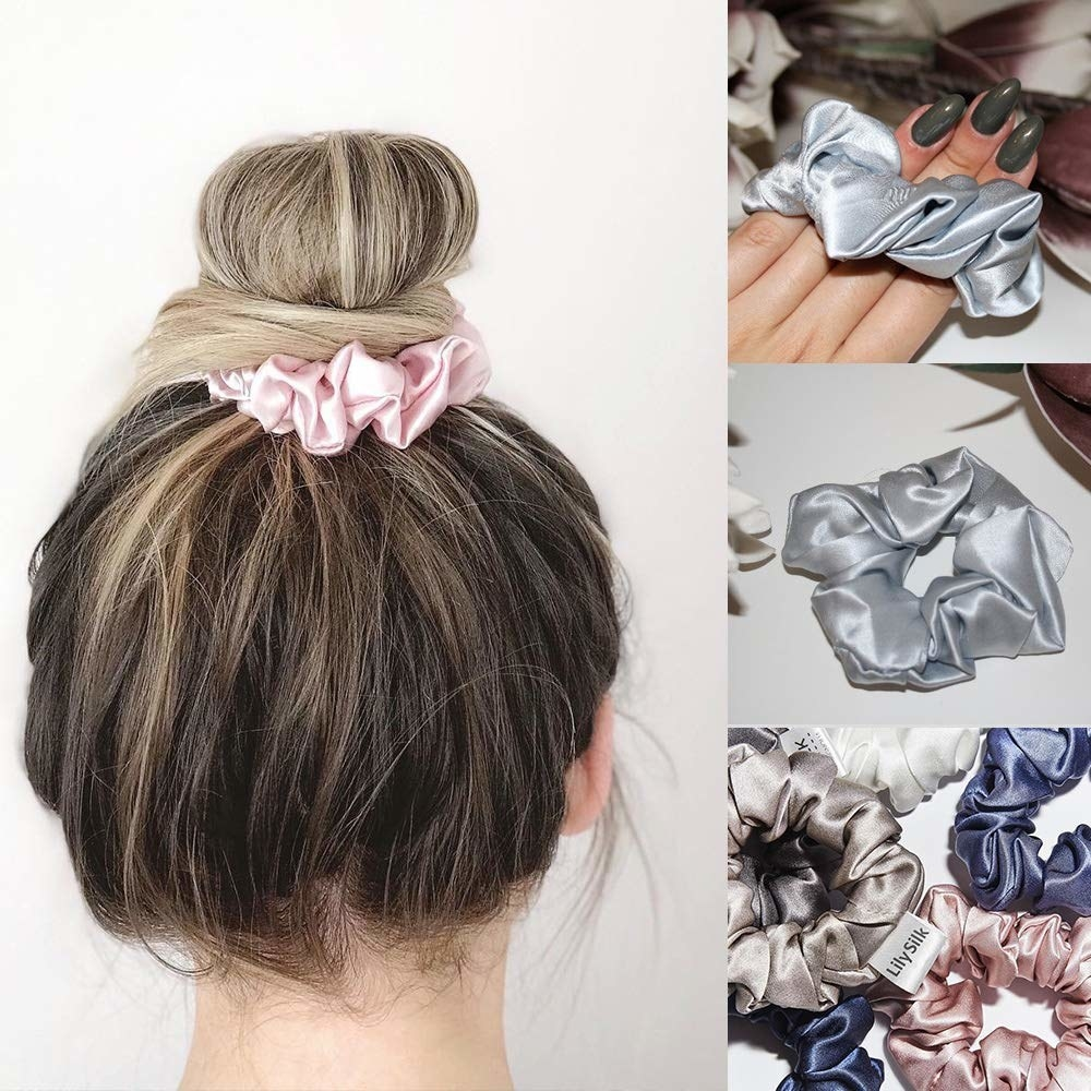 Model wearing the silk scrunchy in light pink and holding a light blue version