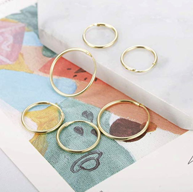 Three pairs of different sized hoop earrings