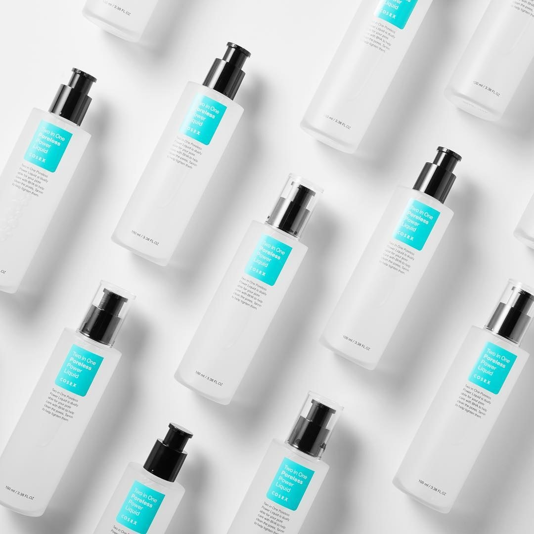 Many bottles of the serum arranged neatly on a simple background