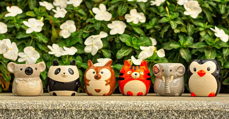 animal pots that look like a koala, panda, tiger, elephant, penguin, and kangaroo