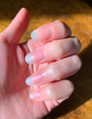 reviewer's long healthy looking nails and cuticles