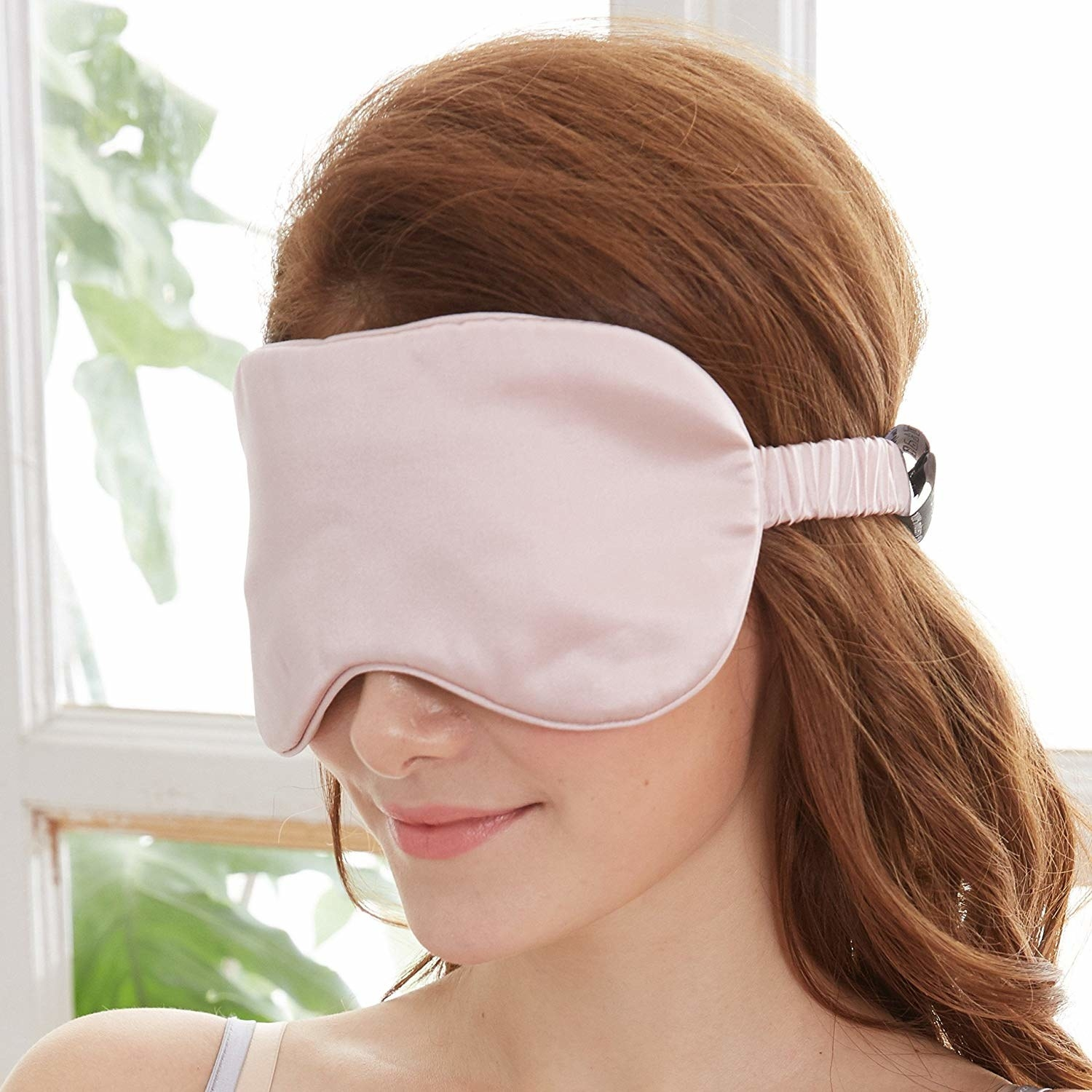 A person wearing the silk eye mask