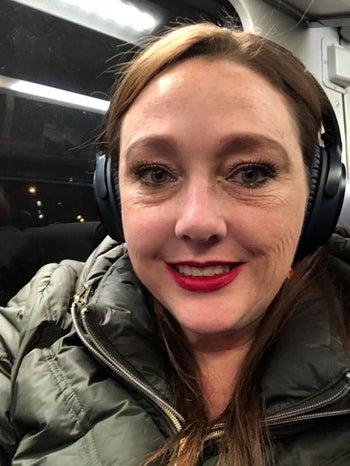 reviewer wearing the headphones
