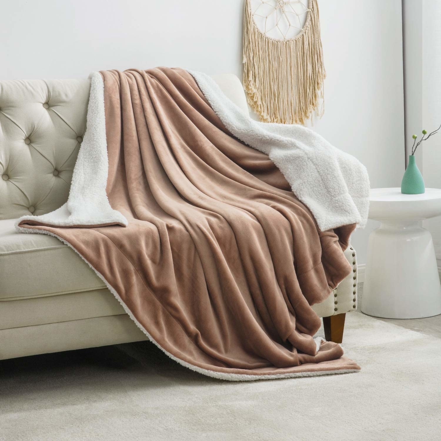 the blanket in brown draped over a couch