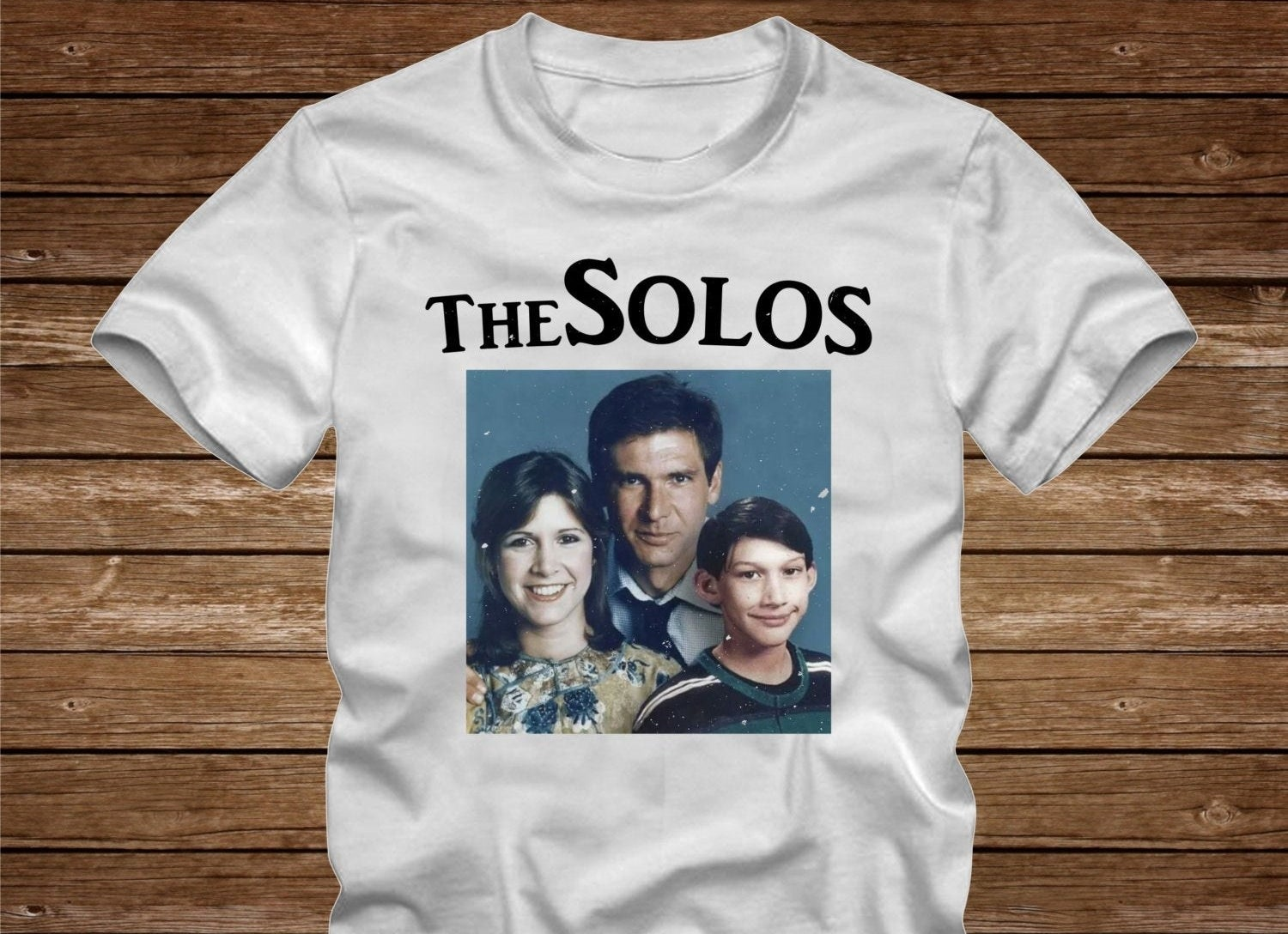 a white tee with a family photo of the solo family
