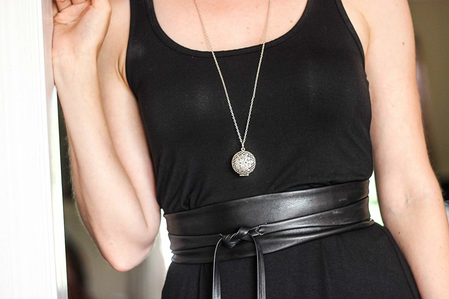 Close up of the aromatherapy diffuser necklace around a model's neck
