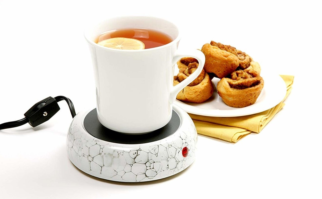 the norpro decorative cup warmer warms a mug of tea