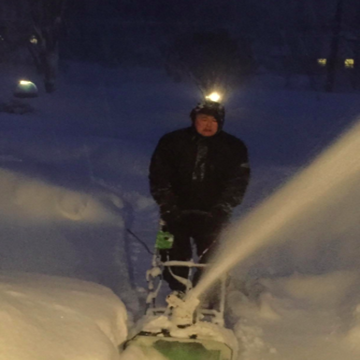 reviewer pic of person using a snow thrower