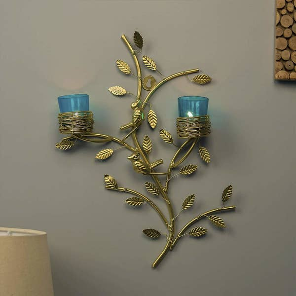 A leaf-shaped candle holder with tealights in it