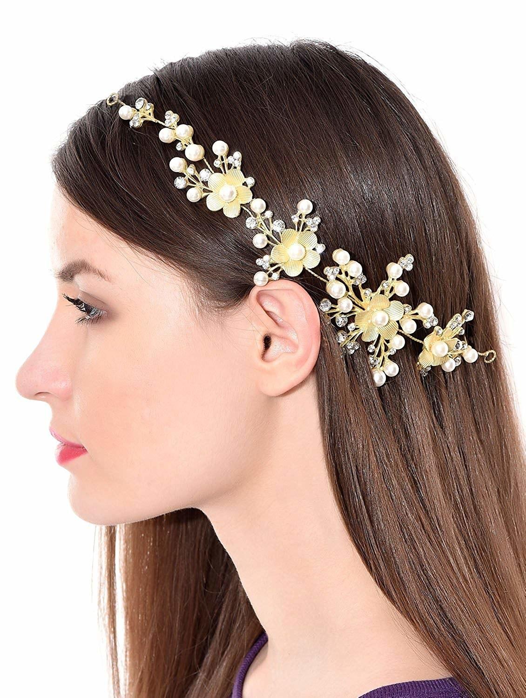 A person wearing the floral hair clip in their hair.