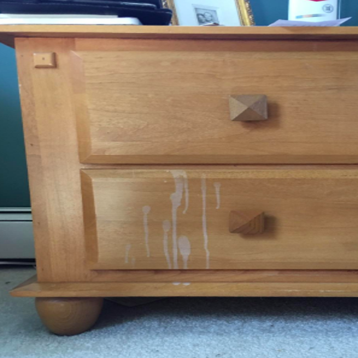 reviewer photo showing nail polish remover stain on night stand