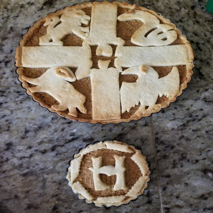 A reviewer's pie topped with the Hogwarts crest