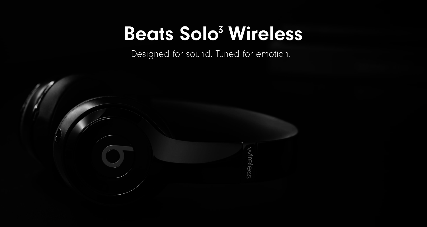 "The headphones in black with text ""designed for sound. tuned for emotion"""