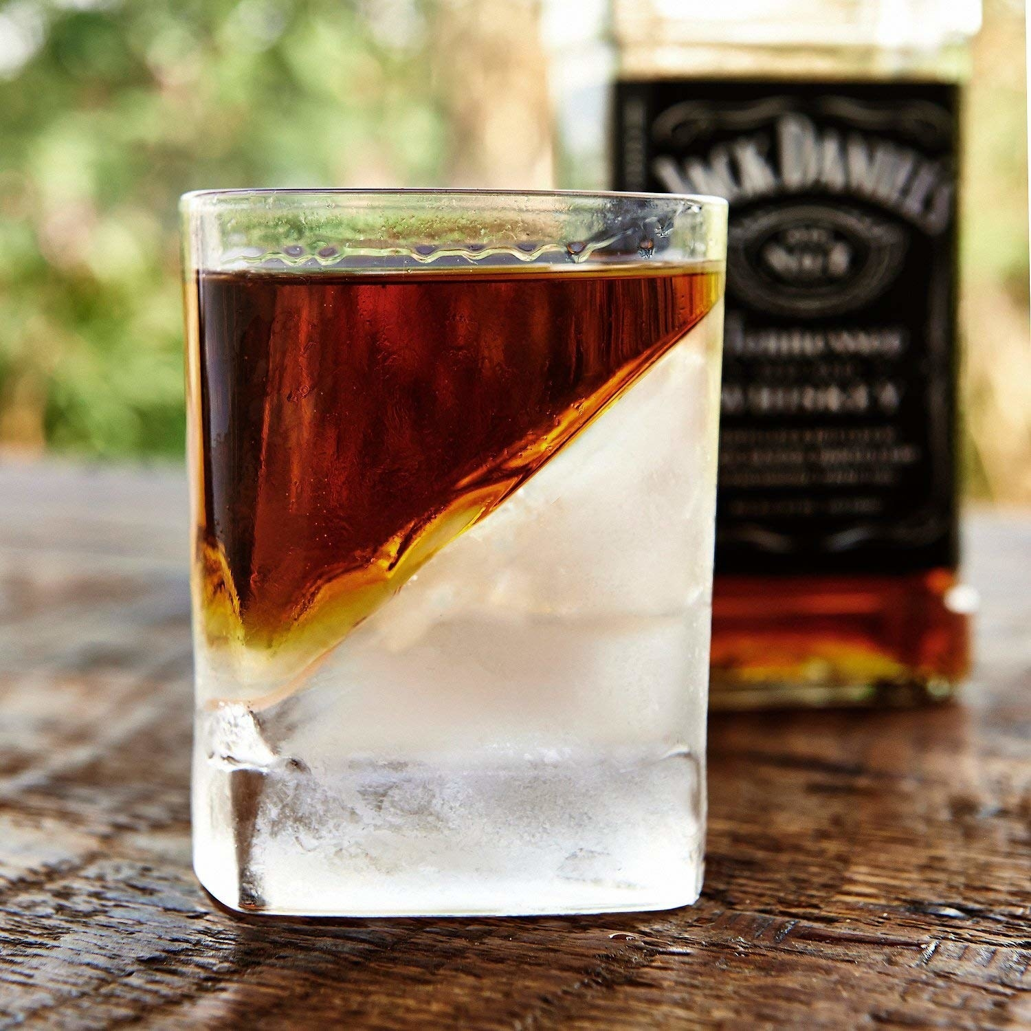 the glass with ice and Whiskey inside