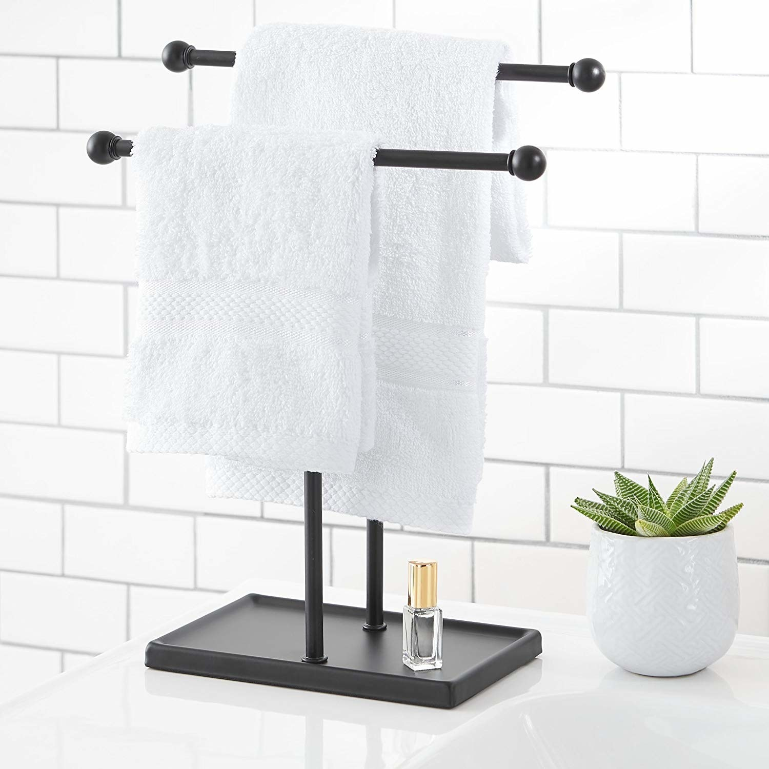 the two-tier towel holder in black with hand towels hanging from each one