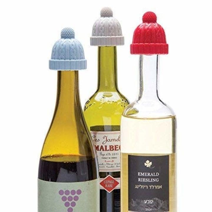 the beanie caps on bottles of wine