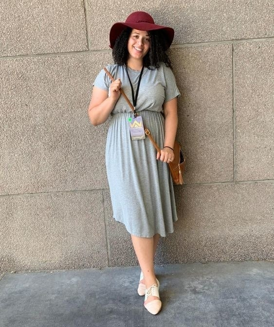 Reviewer wearing the dress in gray
