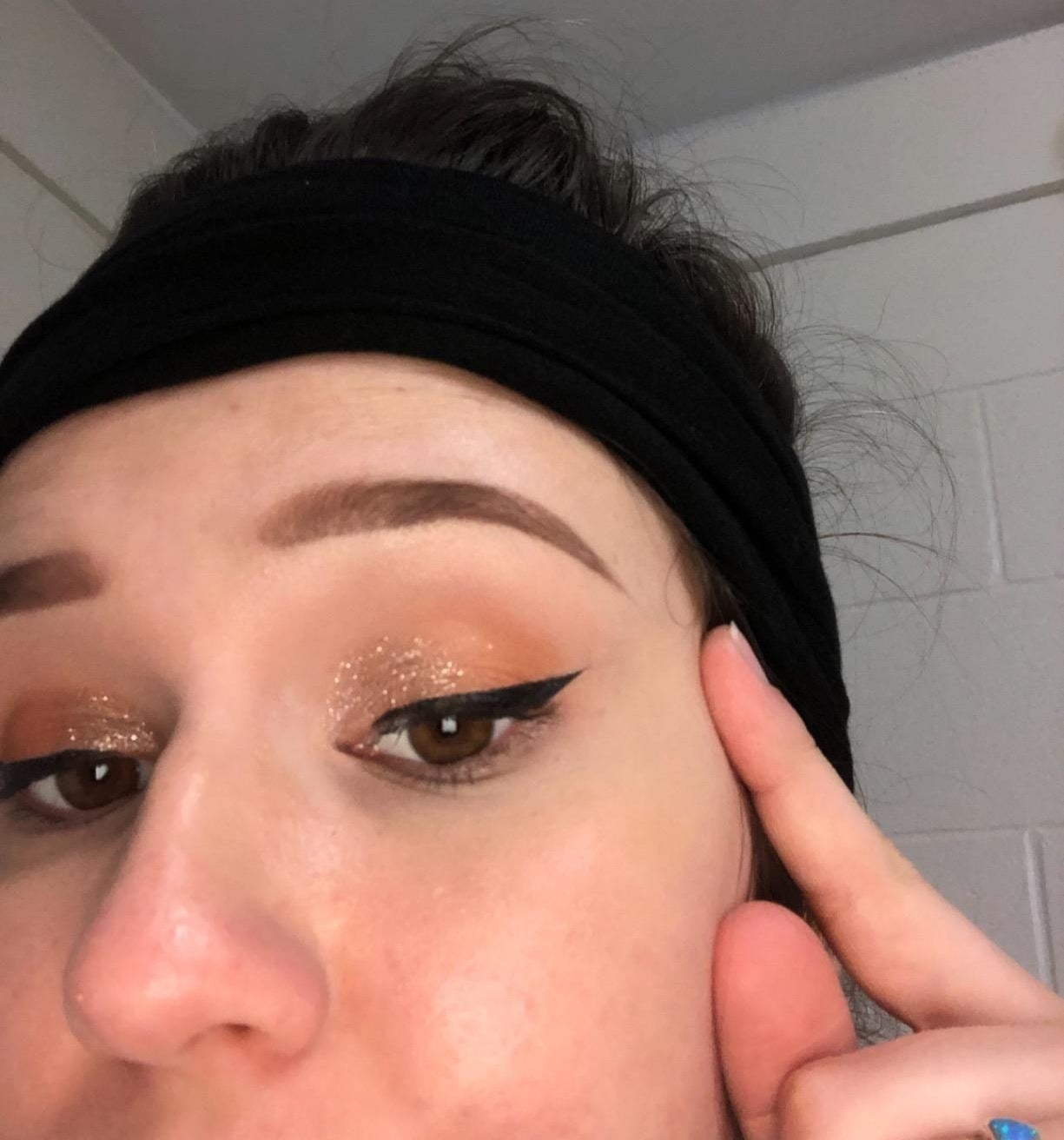 A reviewer showing their eye with a perfect winged eyeliner look