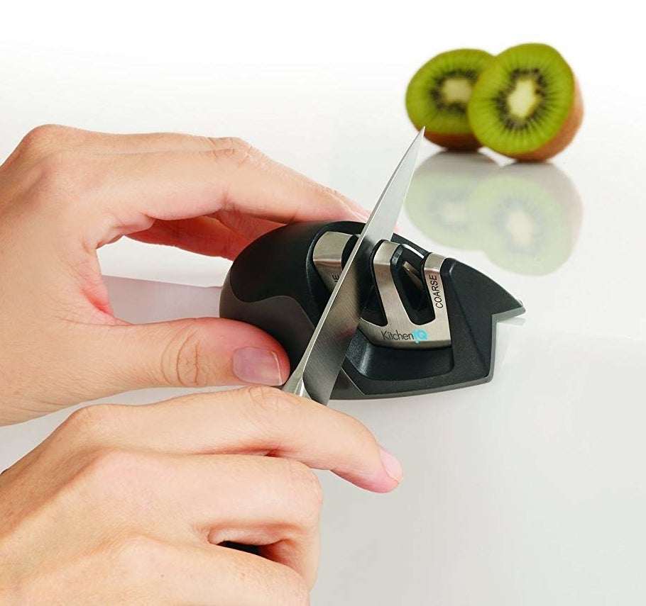 A model using the sharpener on the edge of a counter