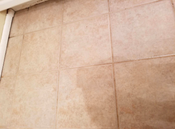 tile floor with light beige clean grout