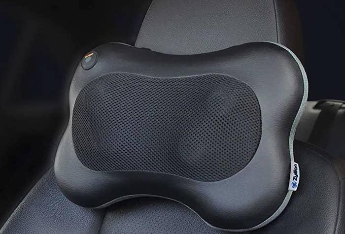the black heated massager pillow