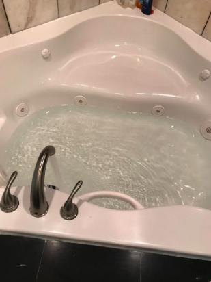 tub running with clear water