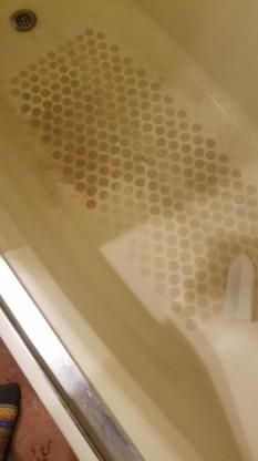 filthy bathtub floor