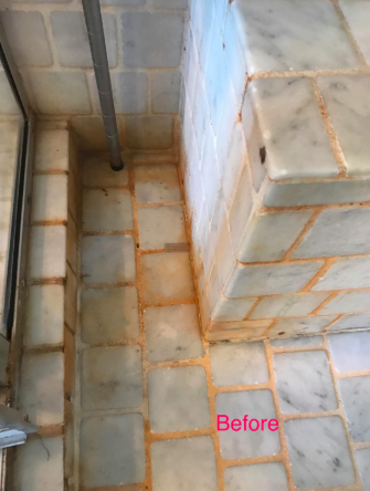 tiled shower with mold on grout